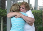 Mom and Kierra giving hugs good bye at the airport