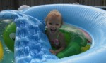 Karalyn having fun with a lot of the pool toys.