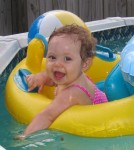 Karsen enjoying her floaty in the pool