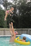 Karalyn getting thrown in the air by her dad