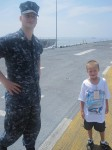 Trenten and Landon on the flight deck of the USS Kearsarge