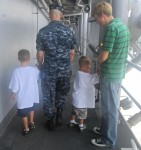 Landon, Layton, and Jamie all listening closely to what Trenten has to say about  his ship (USS Kearsarge)