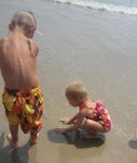 Layton and Lauryn playing in the sand at the beach