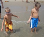 Layton and Landon in the water at the beach