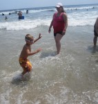 Layton and Ashton playing in the waves together