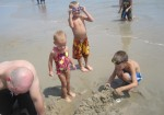 Trenten, Lauryn, Layton, and Landon playing in the sand