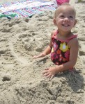 Lauryn buried her legs in the sand