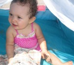Karsen at the beach in her tent