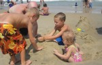 Layton, Trenten, Landon, and Karalyn making sure this Sand Drip Castle is more sturdy