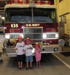 Landon, Layton, and Lauryn got fireman hats to keep